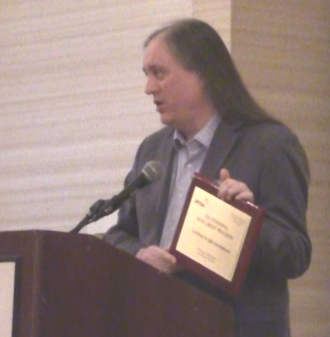 Rovy Brannon Accepts the Outstanding Non Credit Program Award